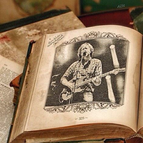 Black and white drawing of Trey singing and playing guitar on a page in a book