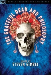 "Book cover with image of skull with roses. Reads ""The Grateful Dead and Philosophy Edited by Steven Gimbel"""